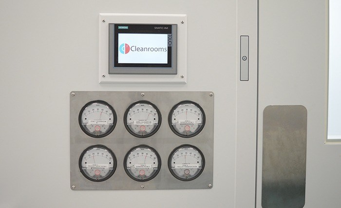 GMP Compliant Cleanroom Features - magnehelic gauges to verify pressure cascades, plus an EMS and door interlocking system